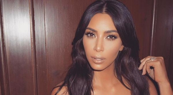Kim Kardashian Hits The Gym Half Naked