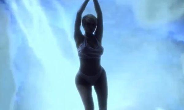 Watch Kim Kardashian & Kylie Jenner Walk in Thongs in Leaked Kanye West Video