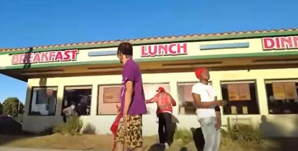 Watch Bompton Rapper Flash Guns During Video Shoot & The Cops Pull Up